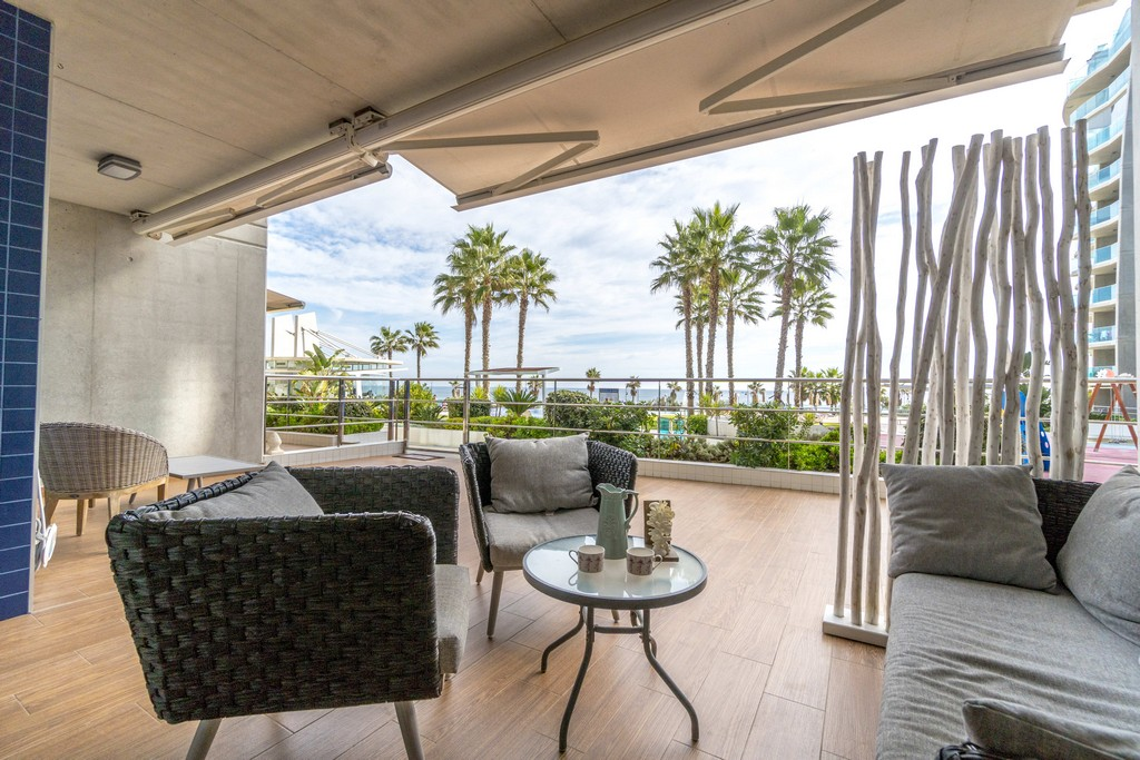 Stunning beachside modern ground floor apartment for sale in a spectacular resort in Punta Prima.