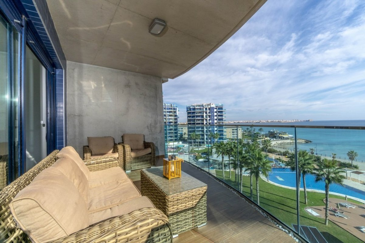 Stunning modern and luxurious apartment for sale on the beach of Punta Prima, Torrevieja.