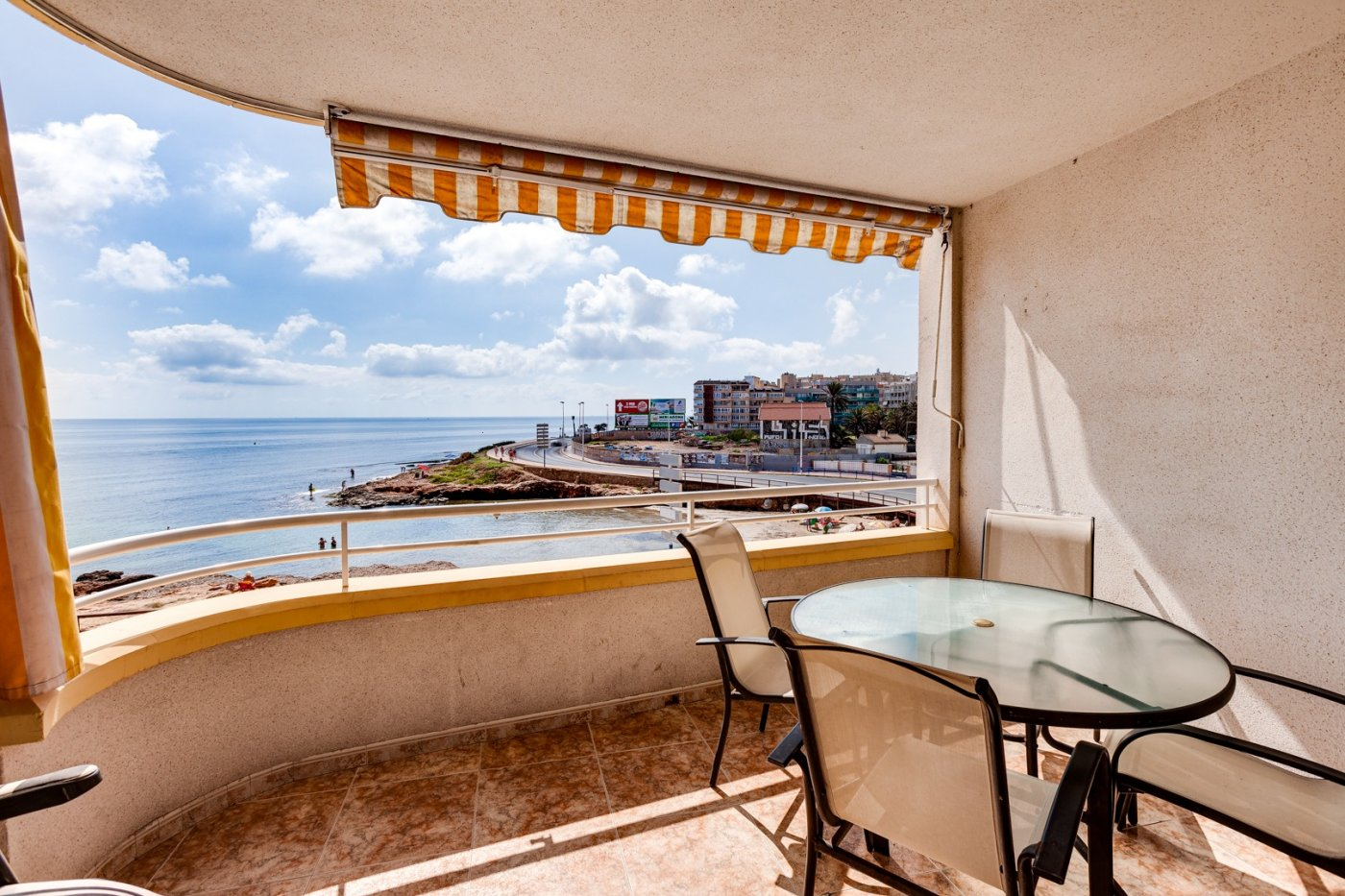 Beach front line apartment for sale with frontal sea views at Curva Palangre in Torrevieja.