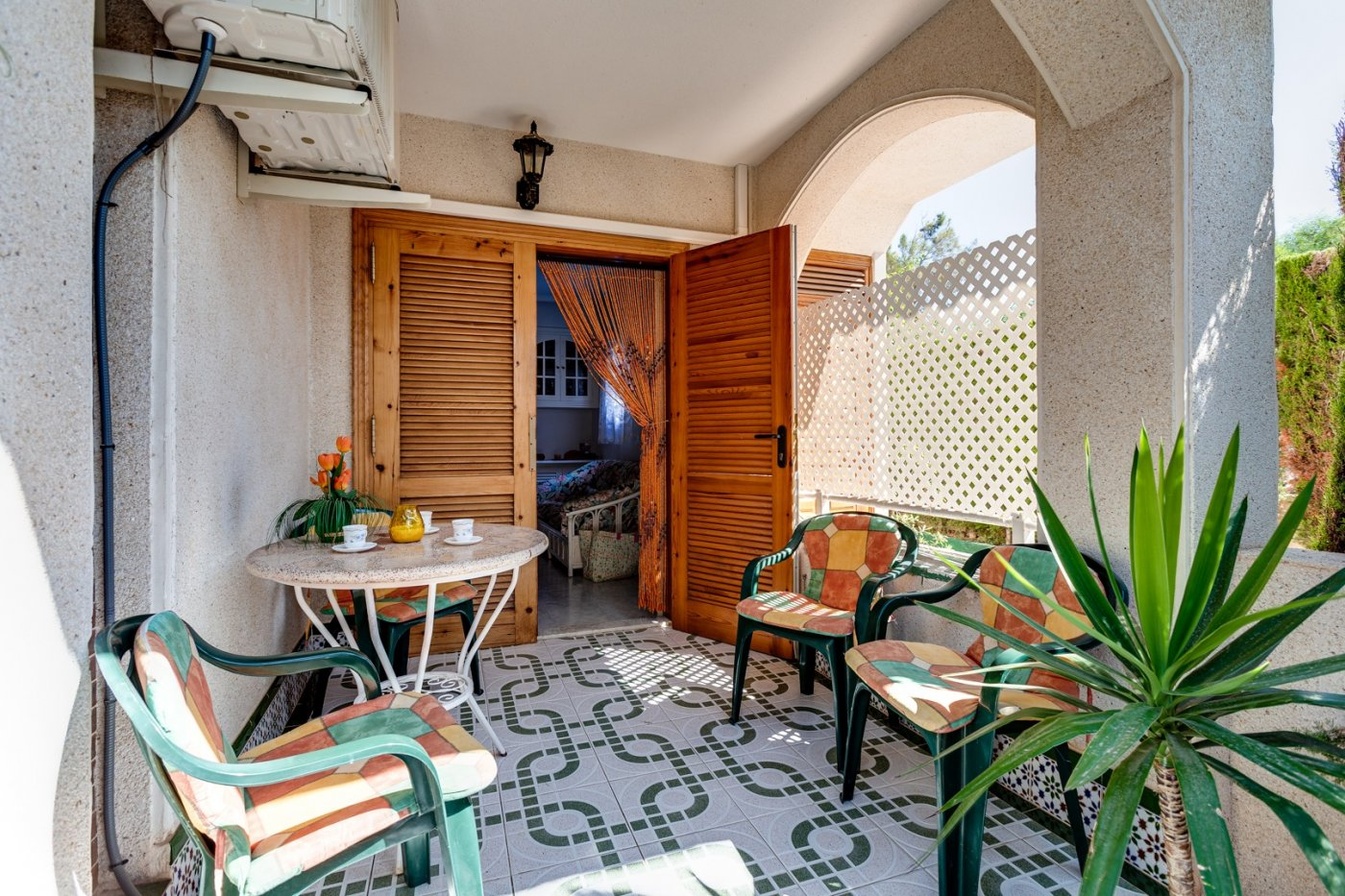 Charming ground floor apartment for sale with a garden in a beautiful complex in Punta Prima near Cala Ferris.